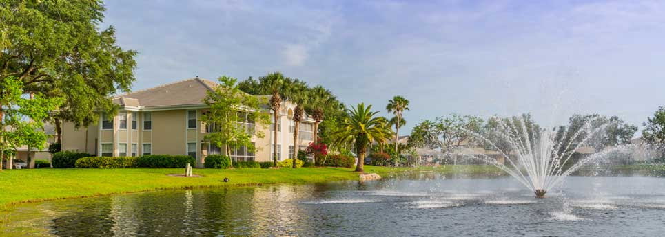 Lake view with fountain at Bellerive community | Vineyards Community Association - Naples, Florida