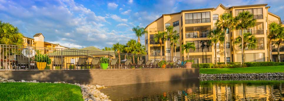 Lake next to pool and hot tub at Concord community | Vineyards Community Association - Naples, Florida